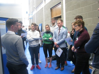 Brian O'Connor presenting his research to Prof. Mary O'Sullivan and his peers